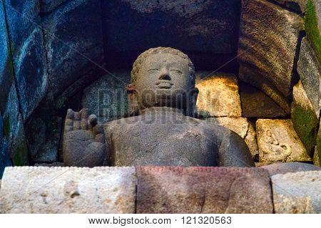 Stone Buddha looks into the distance. (Borobudur, Indonesia)