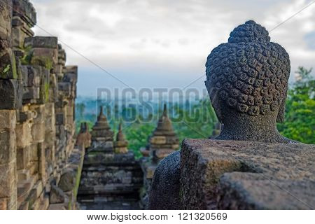 Stone Buddha looks into the distance. (Borobudur, Indonesia) ** Note: Visible grain at 100%, best at smaller sizes