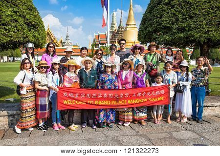 Bangkok, Thailand - Jan 21, 2016 : Unidentified tourists at Wat Phra Kaew temple on Jan 21, 2016 in Bangkok, Thailand. Wat Phra Kaew is one of the most popular tourists destination in Thailand.