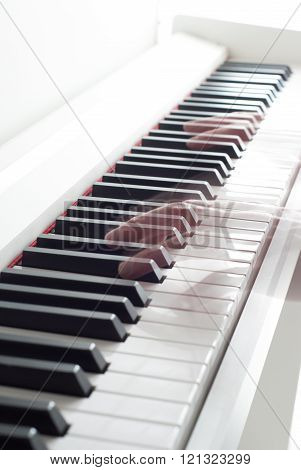 Man playing the piano. Piano keys. Piano playing. Black and white keys. Electronic piano