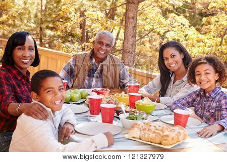 Grandparents With Children Enjoying Outdoor Meal