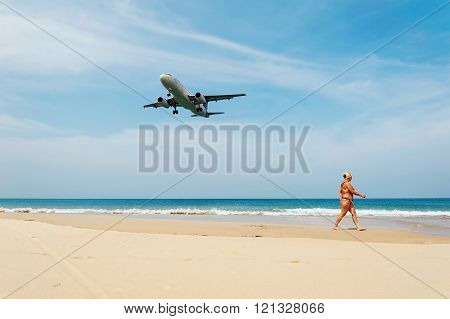 Some people with plane on blue sea
