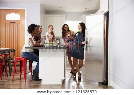 Group Of Female Friends Enjoying Pre Dinner Drinks At Home