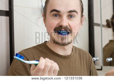 Confused Man About Colored Tooth Brush