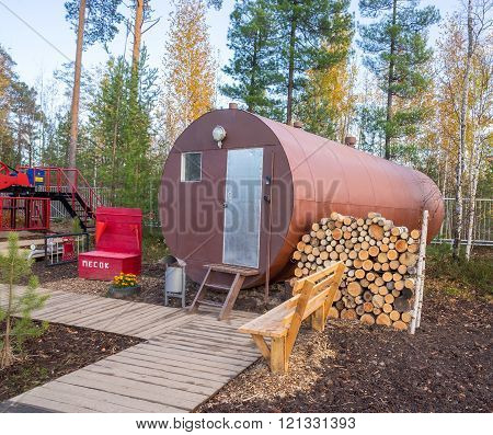 Residential trailer-a barrel with a stock of firewood in the forest. ** Note: Soft Focus at 100%, best at smaller sizes
