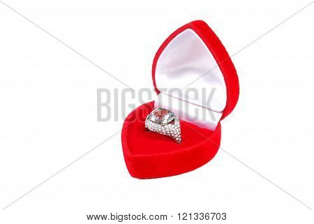 Wedding ring in red case isolated on white