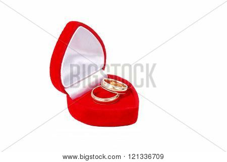 Two Wedding Rings In Red Case On White Background