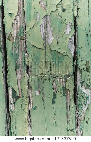 Green paint chipped peeling from wood