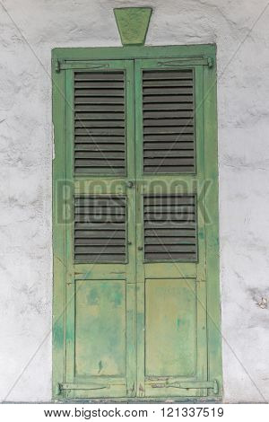 Green paint chipped peeling door wall