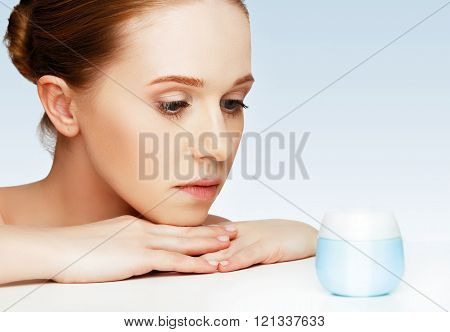 Face Of Beautiful Healthy Woman With Jar Of Cream