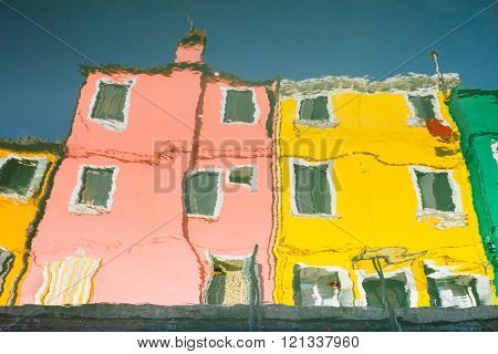 abstract water reflection of colorful houses in Burano, Venice, Italy