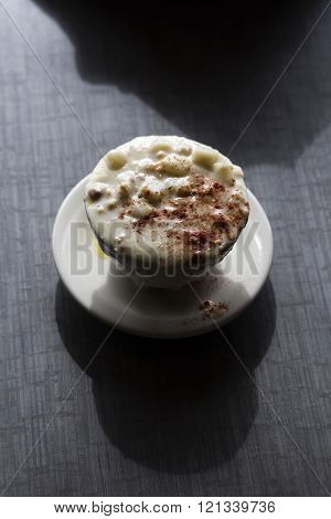 Cup Of Clam Chowder Soup On Grey Table