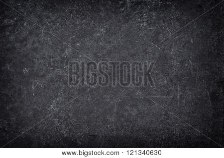 Chalkboard texture. Abstract dark blackboard backgroud with vignette