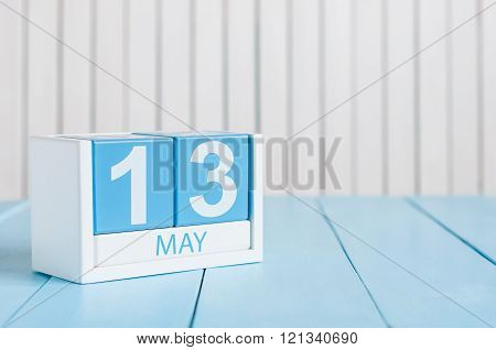 May 13th. Image of may 13 wooden color calendar on white background.  Spring day, empty space for te