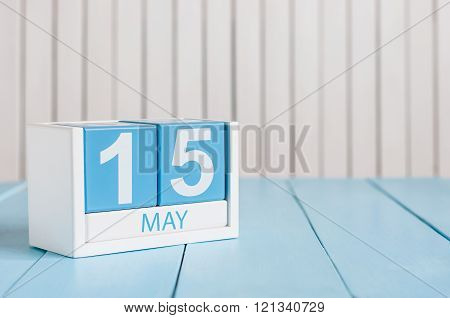 May 15th. Image of may 15 wooden color calendar on white background.  Spring day, empty space for te