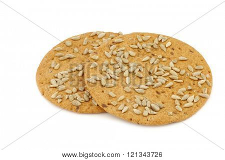 crispy spelt crackers with sunflower seeds on a white background