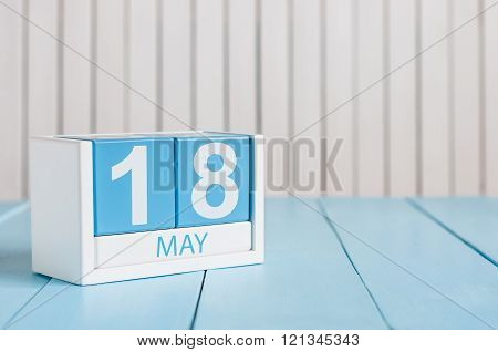 May 18th. Image of may 18 wooden color calendar on white background.  Spring day, empty space for te