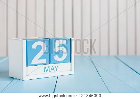 May 25th. Image of may 25 wooden color calendar on white background.  Spring day, empty space for te