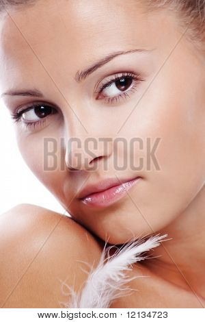 Beautiful female with clean healthy skin close-up over white