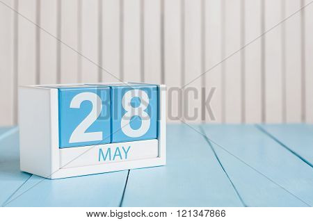 May 28th. Image of may 28 wooden color calendar on white background.  Spring day, empty space for te