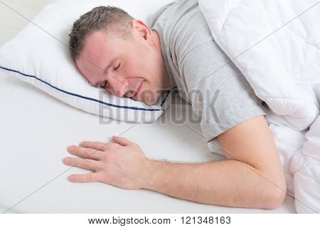 Man peacefully sleeping at home