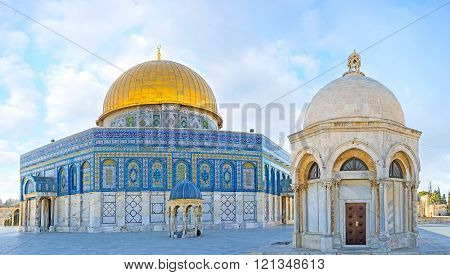 The white stone Hebron Dome with the small Dome of the Prophet and the Dome of the Rock on the background Jerusalem Israel.