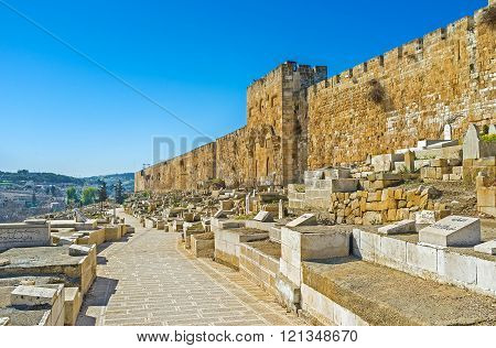 JERUSALEM ISRAEL - FEBRUARY 16 2016: The Muslim cemetery at the eastern wall including the Golden Gate (Gate of Mercy) on February 16 in Jerusalem.