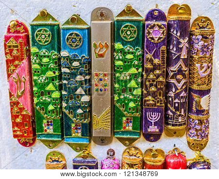 The mezuzah is affixed to the doorframe of homes in Jewish culture also popular as the protection symbol souvenir from Israel.