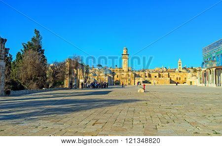 JERUSALEM ISRAEL - FEBRUARY 16 2016: The large square next to the Dome of the Rock with the stone walls and belfries of the old city on the background on February 16 in Jerusalem.