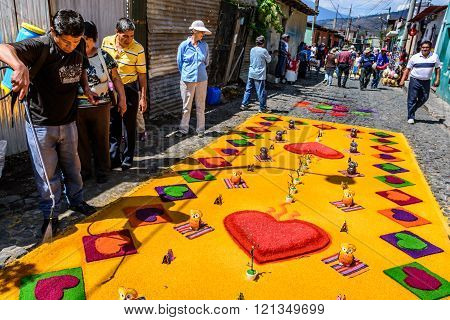Watering Colorful Lent Carpet Of Hearts, Antigua, Guatemala