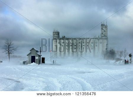 COLLINGWOOD, ONTARIO - JAN 19,2016 Winter storm at the old shipping grain storage terminal under an angry sky. Fresh snow for the people who love to ski.