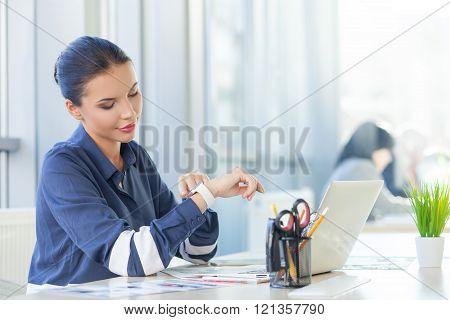 Beautiful female worker using modern technology