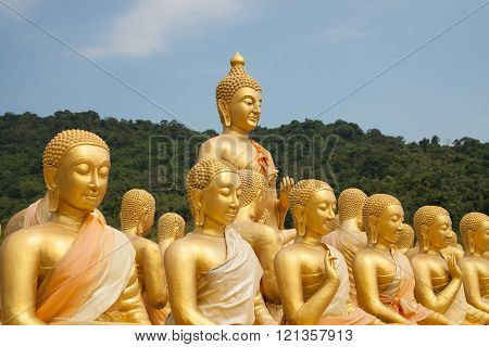 Golden big buddha statue in thai temple