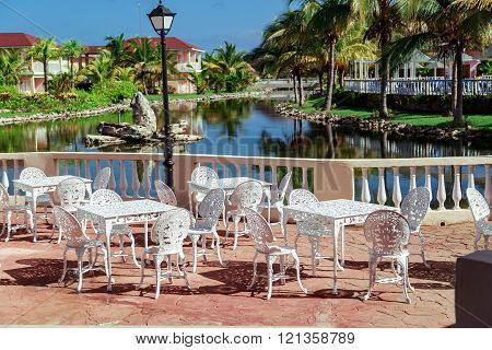 Amazing , gorgeous inviting view of Memories resort landscape, outdoor cafe patio with vintage chair