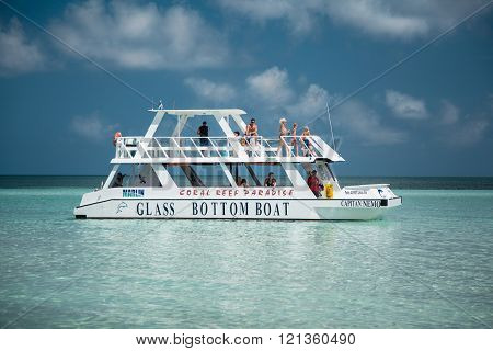 Amazing gorgeous stunning view of glass boat with people on board going in tranquil azure ocean