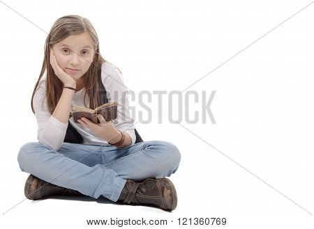 Preteen Girl Reads A Book, Sitting  Crossed-legs