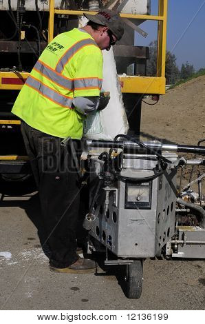 Workman Handles Thermoplastic Paint