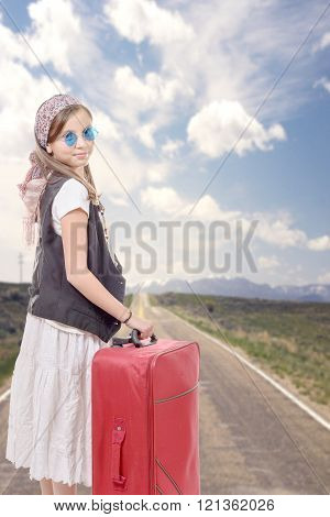 Young Girl On Road With Vintage Clothes And Suitcase
