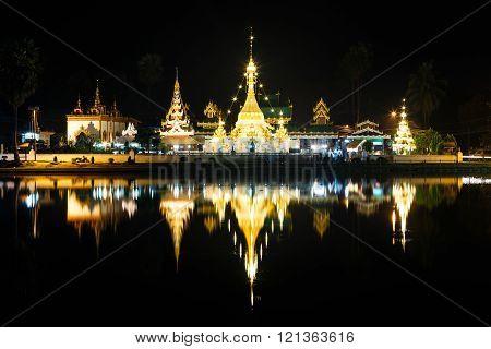 Wat Jong Klang and Wat Jong Kham at night with market in Mae Hong Son ,Thailand