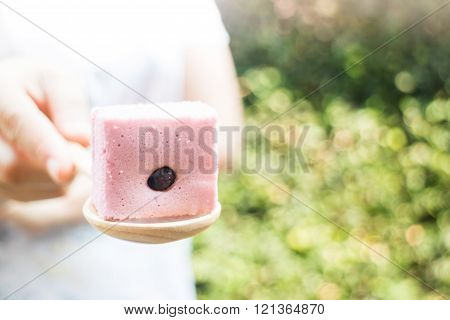 Hand on serving Thai steamed cotton cake stock photo