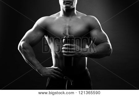 Man bodybuilder is holding a shaker for drinks