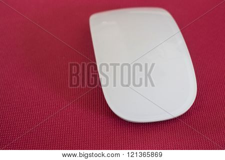 Wireless computer mouse on pink background stock photo