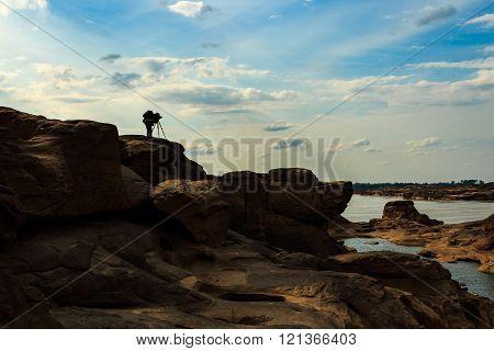 Man take photo on grand canyon sam pan bok at ubonratchathani