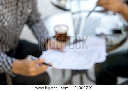 blur bussiness man hand paper work
