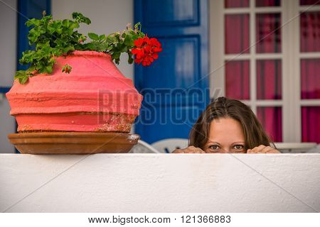 Young Beautiful Woman Hiding Behind White Wall. Concept For Advertisement.