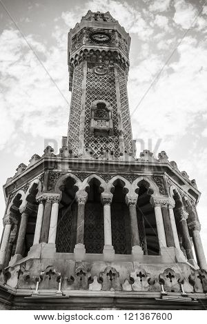 Izmir. Historical clock tower under cloudy sky