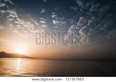 Dramatic Colorful Seascape. Sun, Evening Sky