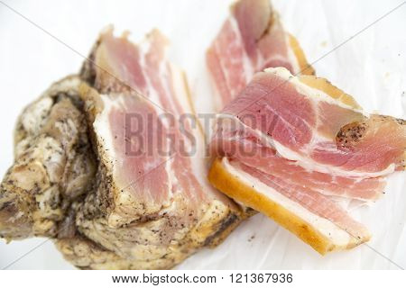 Salty bacon. The whole piece and sliced slices