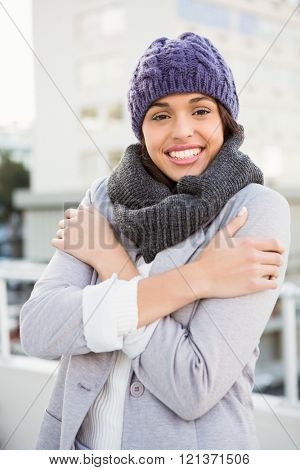 Thoughtful woman in winter coat trembling outdoor