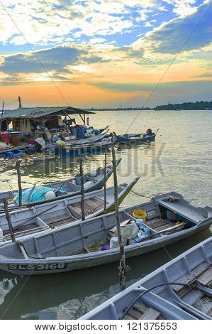 KLANG MALAYSIA - FEBRUARY 08 2016 : Traditional wooden fisherman boats park at the jetty with sunset background